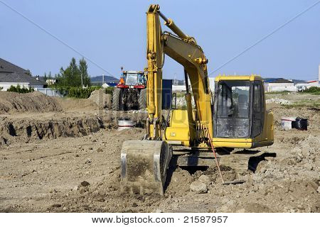 Yellow Digger At Big Job Site