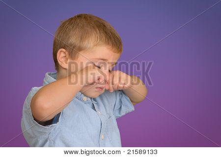 Child Rubbing his Eyes