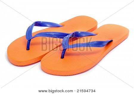 a pair of orange flip-flops on a white background
