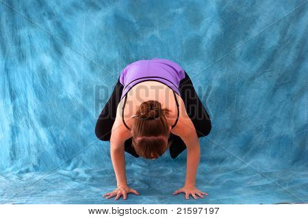 Front View Of Yogi In Crow Pose
