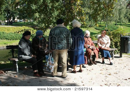 Editorial use. Discussion in a Park of Riga