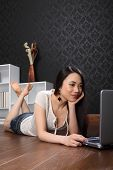 Beautiful Chinese Woman At Home Surfing Internet
