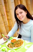 foto of chinese food  - girl eating chinese rice in a restaurant - JPG