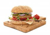 Board with tasty bacon burger, isolated on white poster