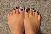foto of painted toenails  - Feet showing painted toenails - JPG