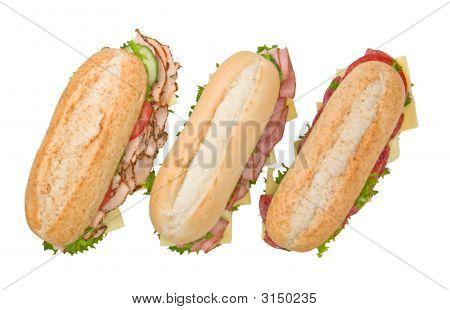 Three Submarine Sandwiches On White Background