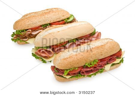 Three Delicious Submarine Sandwiches Isolated On White