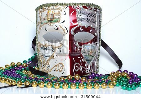 Mardi Gras mask from New Orleans with beads