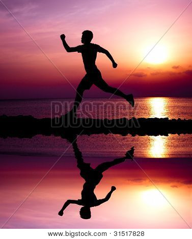 Young Runner With Water Reflecting