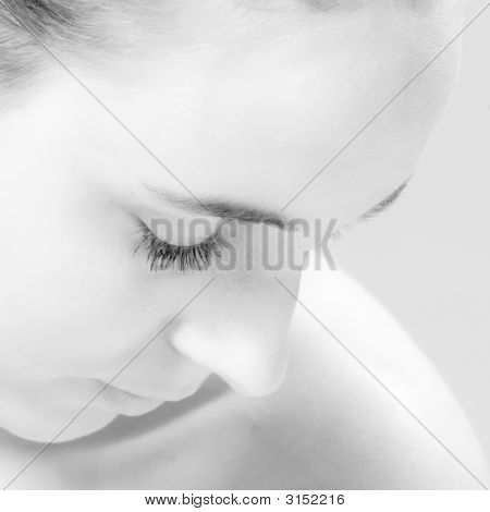 Up Close And Personal Portrait Looking Sown In Black And White