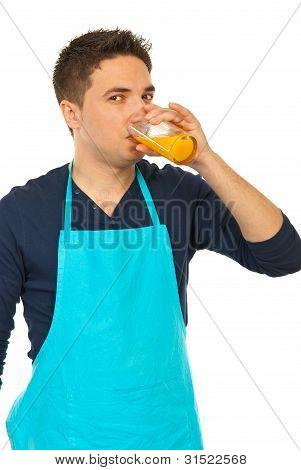 Young Chef Drinking Orange Fresh
