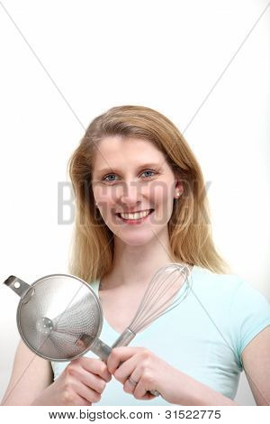 Attractive Woman With Kitchen Utensils