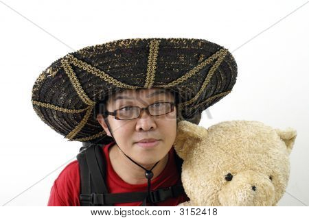Asian Tourist With Mexican Hat