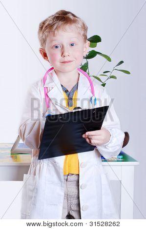 Smiling Little Boy In Doctor's Uniform