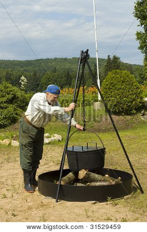 Senior Preparing Camping Fire