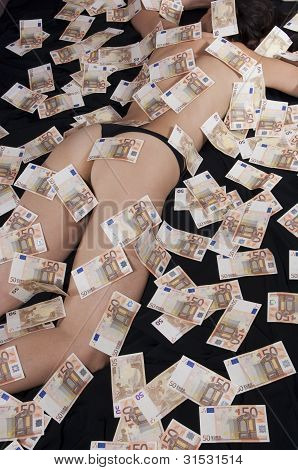 Women Covered With Banknotes On The Bed