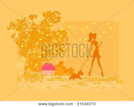 Girl walking with her dog in autumn landscape