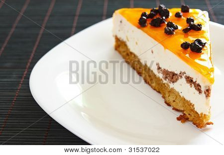 Orange Jelly Cake With Mousse And Cranberries On Top