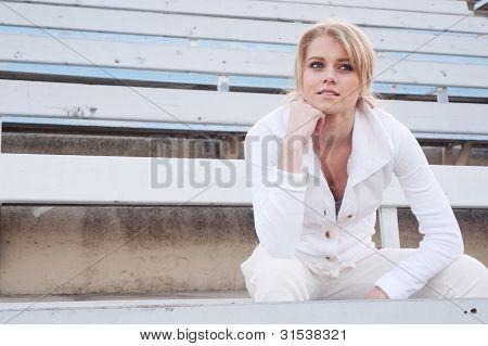 Female Athlete Sitting In The Bleachers