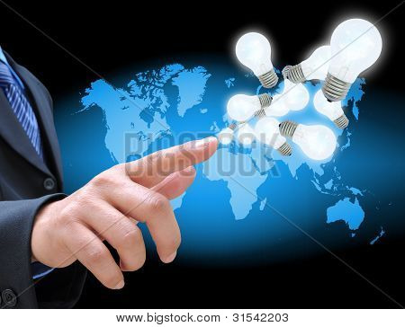 businessman hand holding light bulb