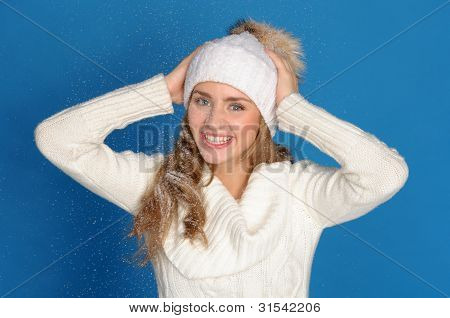 Happy Woman In Winter Clothes Under Falling Snow