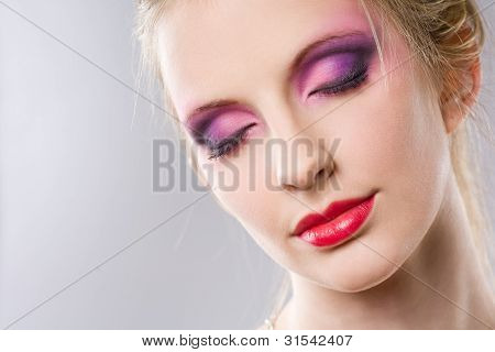 Closeup Portrait Of A Blond Beauty With Elegant Makeup.