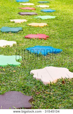 Colorful Stone Block Walk Path In The Park With Green Grass Background