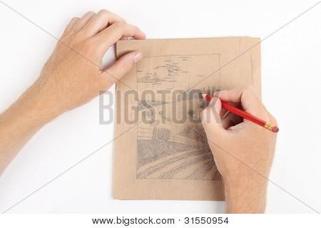 Man Hands Draw Picture With Landscape On Brown Paper