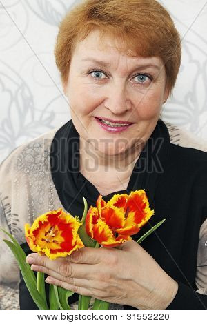 Lady Holds A Tulips