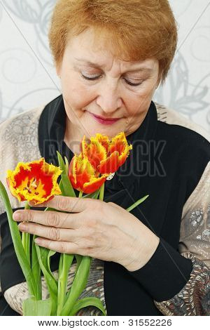 Lady Smelling A Tulips