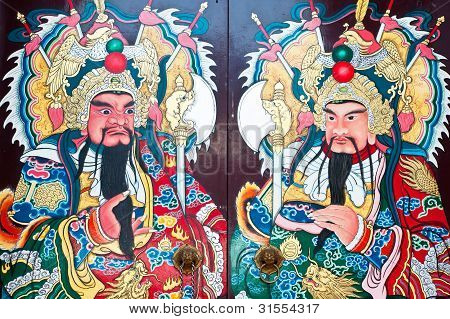 Traditional Type Of Temple Gate In China Town Thailand. God Of China On The Door