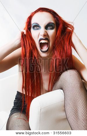 Expressive gothic woman with artistic makeup