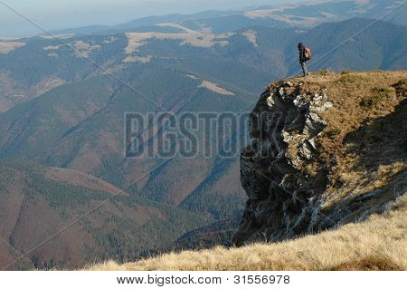 Alone trekking woman in the mountains