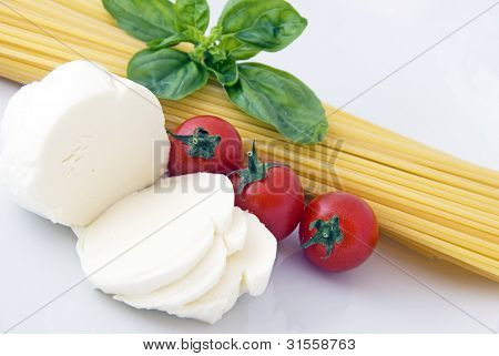 Italian food: spaghetti, mozzarella, cherry tomatoes and basil