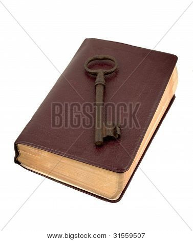 Old Key On A Leather Book