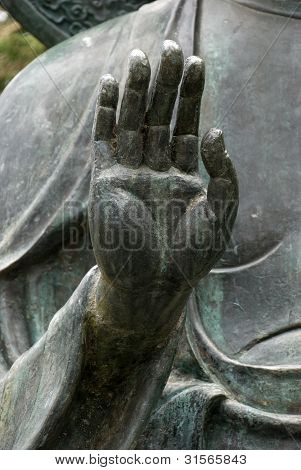 Buddha's Right Hand Laced with Spiderwebs and  in Abhaya Mudra Gesture
