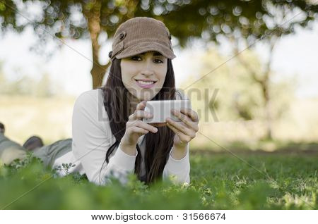 Young woman taking a break and texting on a hiking trip