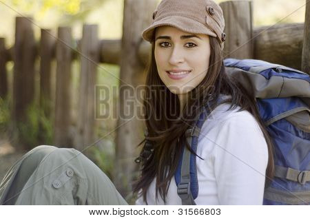 Young woman taking a break on a hiking trip