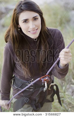 Young woman ready to rappel down