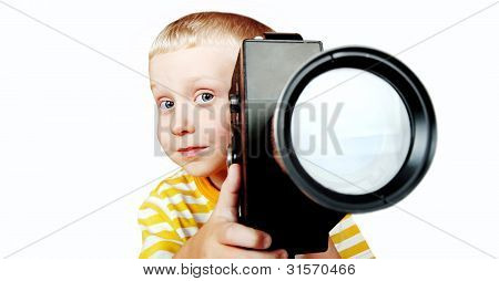 Boy With Old Movie Camera