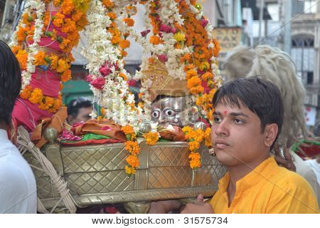 Holy Devotee carrying Lord Shiva Hatkeshwar into the city