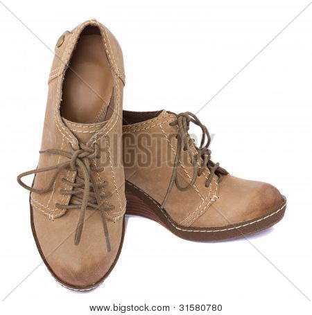 pair of woman leather boots