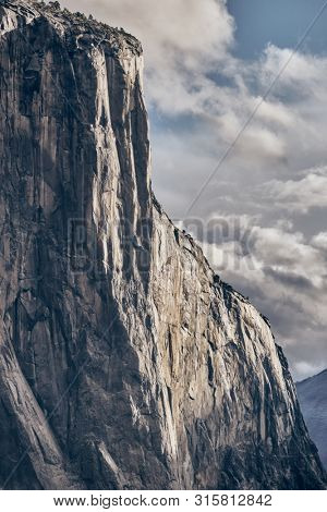 poster of El Capitan rock close-up in Yosemite National Park Valley at cloudy autumn morning from Tunnel View.
