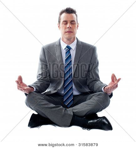 Businessman Meditating In Lotus Position