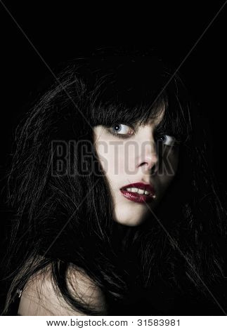 Portrait Of Beautiful Scared Goth Girl Among The Dark