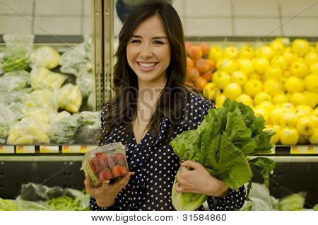 Cute woman buying healthy food