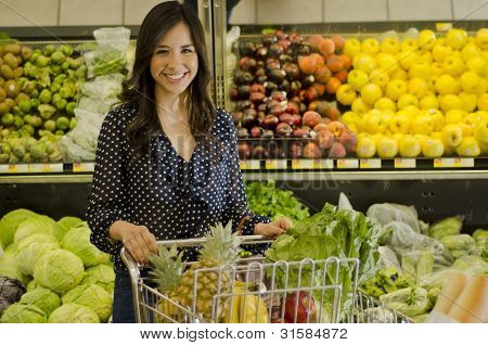Happy woman at the grocery store