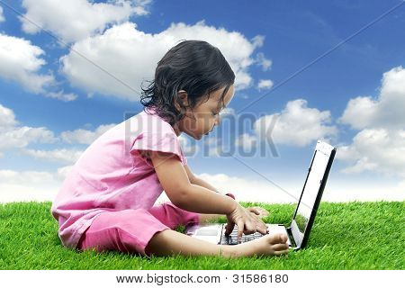 Adorable Girl With Laptop Computer
