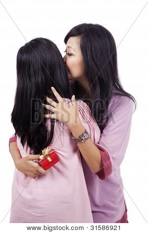 Mother And Daughter With Present