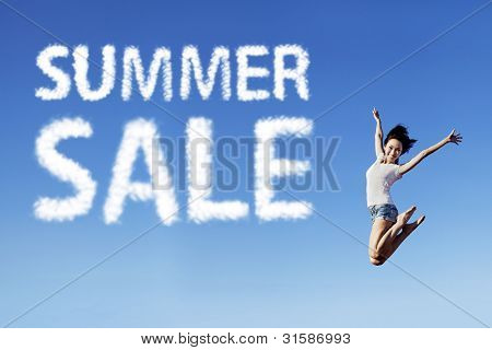 Happy Woman Jumping With A Discount Sign
